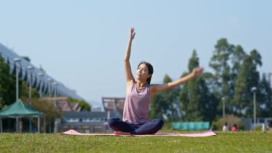 Thumbnail for Woman do yoga at park