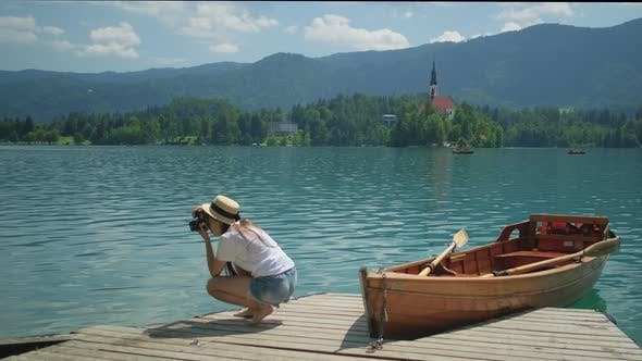 Girl Taking Pictures of Lake Bled in Slovenia