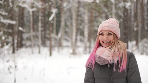 Cover Image for Slow Motion, Winter Woman in the Woods Watching the Snow Fall and Smiling Looking at the Sky and