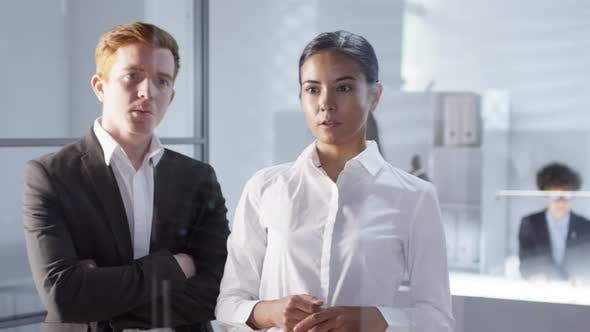 Thumbnail for Business Lady Using Invisible AR Screen and Talking with Male Colleague