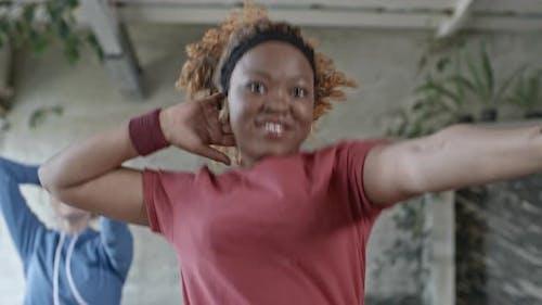 Cheerful Woman in Aerobics Class