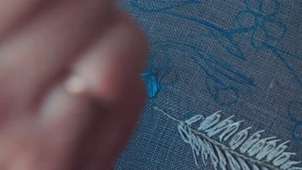 Womans Hand is Embroidered with Tribal Native Fabric