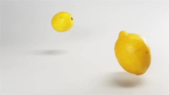 Thumbnail for Few Lemons Falling Down on White Wet Surface