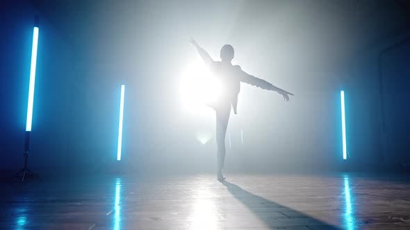 Silhouette of Contemporary Dancer Woman on Spotlight Background