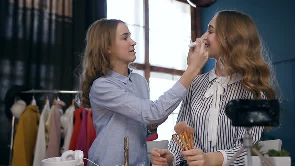 Thumbnail for Professional Female Make up Artist Doing Make up for the Young Model