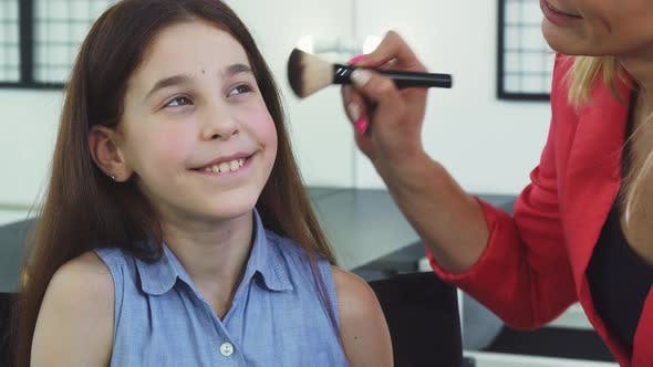 Thumbnail for Pretty Little Girl Smiling While Her Mom Applying Makeup on Her Face