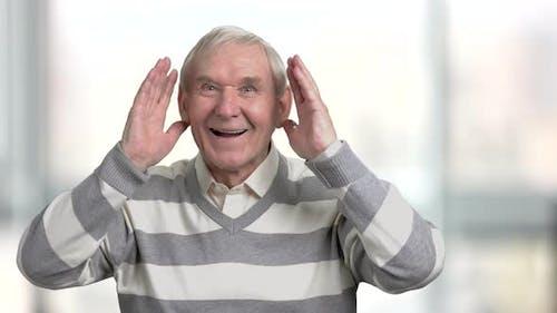 Happy Older Man Cheering for Sport Team.