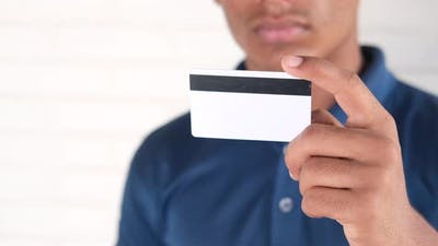 Close Up of Person Hand Holding Credit Card