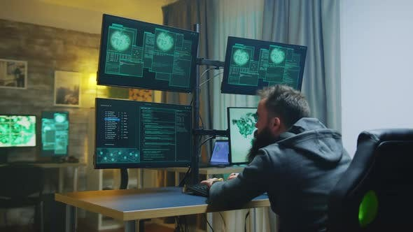 Dangerous Hacker with Hands Raised After Breaking Government Firewall