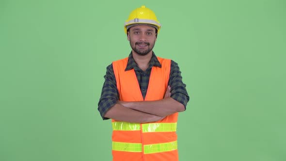Thumbnail for Happy Young Bearded Persian Man Construction Worker Smiling with Arms Crossed