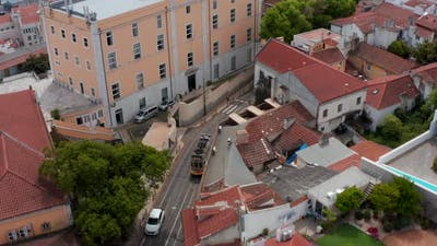 Aerial View of Tramway Driving in Town Streets