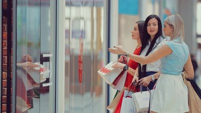Beautiful Girlfriends Being Excited About Shopping Sales