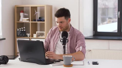 Happy Young Man with Laptop and Microphone at Home 20