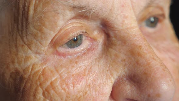 Thumbnail for Portrait of Elderly Woman Watching Pensive To Something. Close Up of Female Eyes with Wrinkles