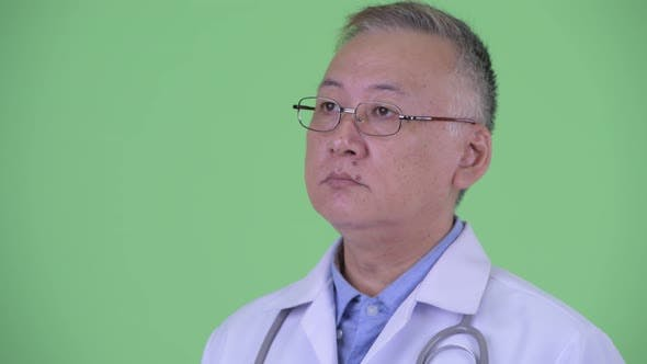 Thumbnail for Face of Happy Mature Japanese Man Doctor Thinking