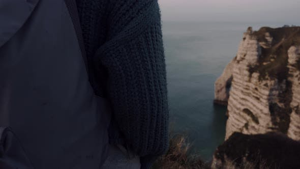 Thumbnail for Super Close-up Female Tourist with Backpack Watching Majestic Pink Sunset Sea Cliffs Panorama Over