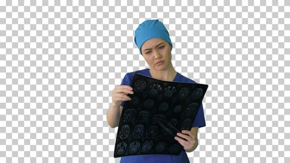 Thumbnail for Female doctor looking at brain tomography, Alpha Channel