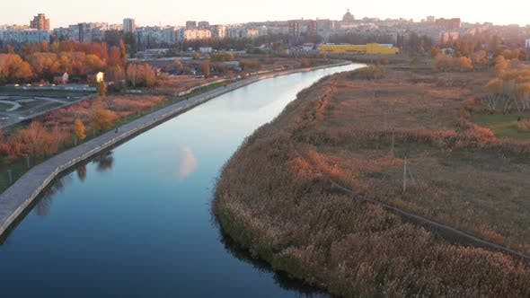Thumbnail for River in the city overgrown with reeds