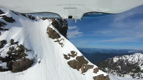 Cover Image for Extreme Winter Mountain View Flying Helicopter Close To Mountain Snowy Rocks