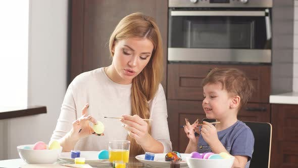 Thumbnail for Portrait of Happy Family Decorating Eggs for Easter