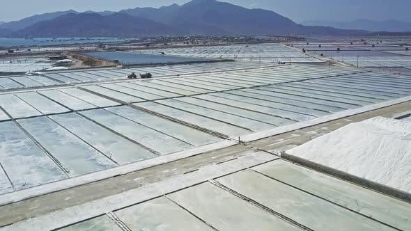 Thumbnail for Vehicle Drives Among Salt Plantations Against Hills