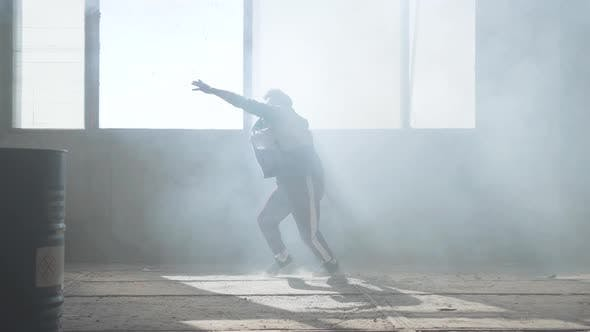 Cover Image for Young Man Dancing in an Abandoned Building