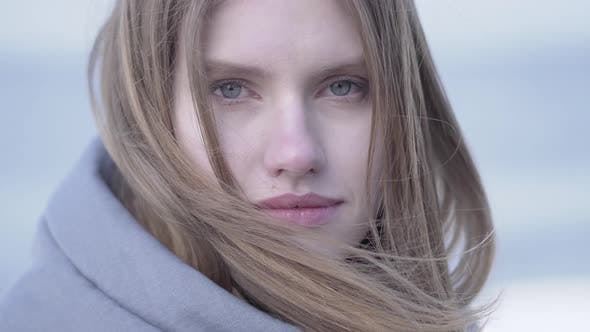Thumbnail for Beautiful Young Blond Woman with Long Hair and Blue Eyes Looking in the Camera