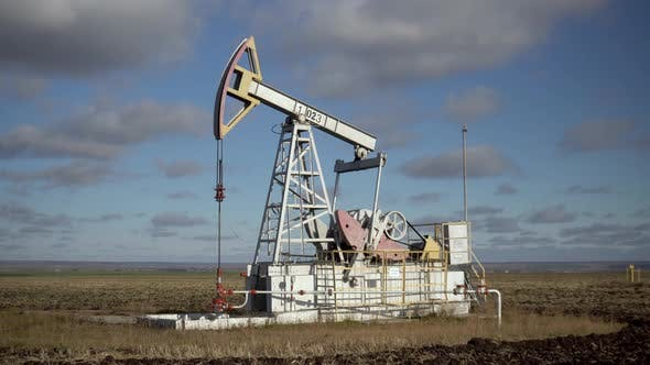 An Oil Rig Extracts Raw Materials From Underground in the Steppe.