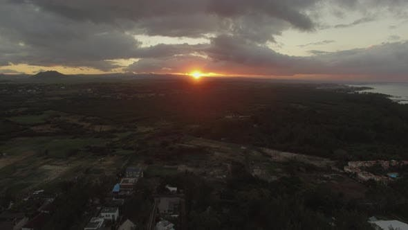 Thumbnail for Flying Over Green Mainland in Mauritius at Sunset