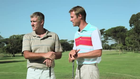 Thumbnail for Mature men chatting on golf course