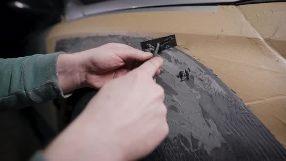 Thumbnail for A Close-up of a Man's Hand with a Tool. A Professional Removes the Form From the Clay with the Help