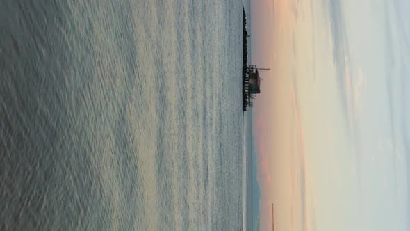 Vertical video of Ocean at sunset