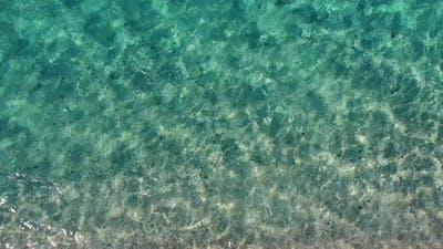 Water Texture on Sandy Beach