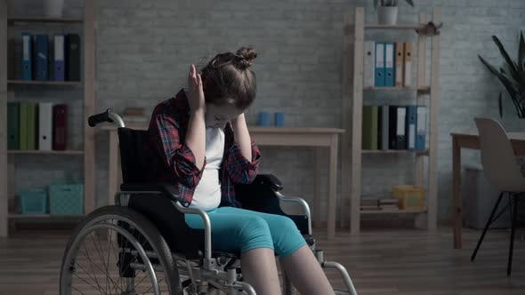 Lonely Frustrated and Sad a Disabled Child in the Room