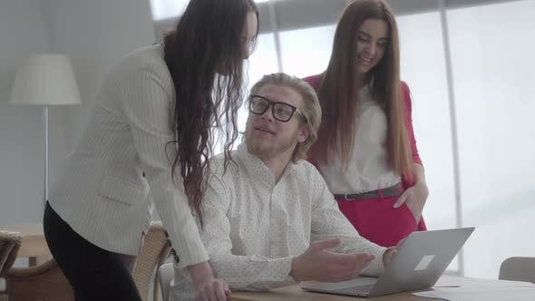 Thumbnail for Portrait Successful Blond Man in Glasses Sitting in a Light Comfortable Office