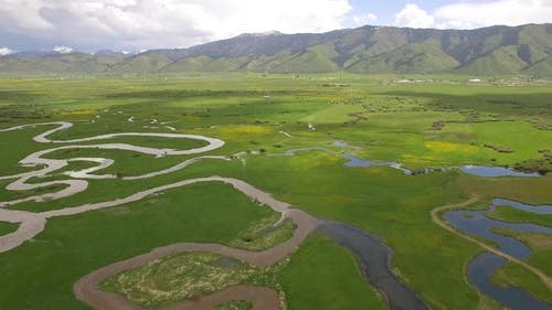 View of river winding through green valley