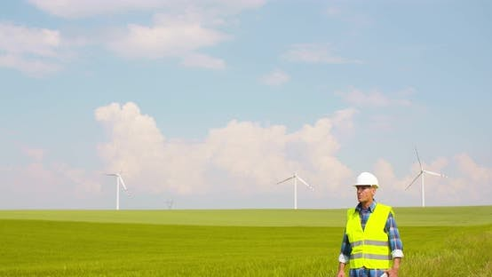 Thumbnail for Engineer Using Digital Tablet at Windmill Farm