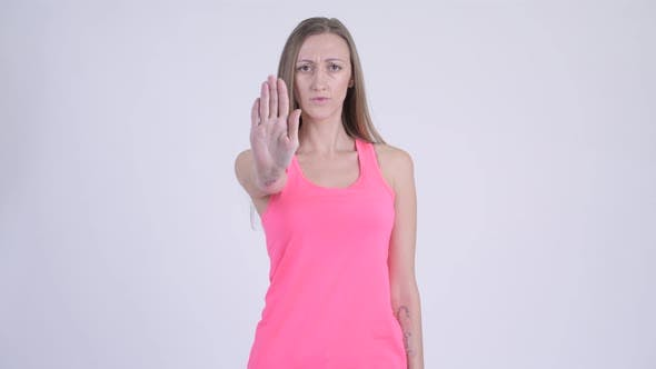 Thumbnail for Portrait of Serious Blonde Woman Showing Stop Gesture