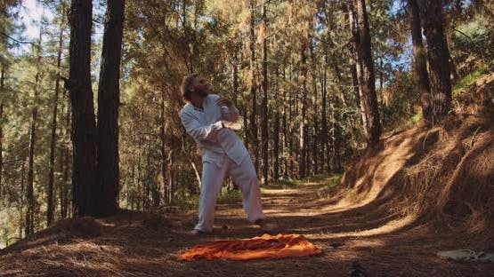 Young Man Dancing In Forest