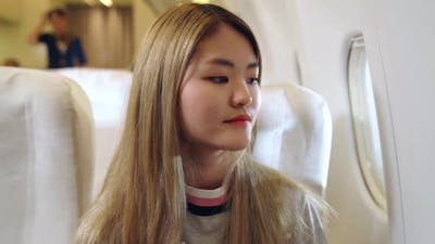 Happy Asian Woman Travel in Airplane