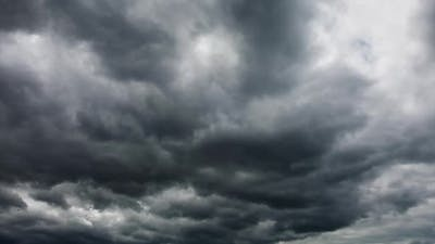 Majestic Gray Clouds Flying Over the Horizon