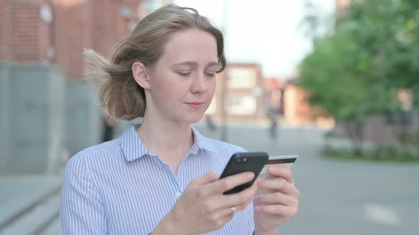 Portrait of Woman Having Online Payment Success on Smartphone