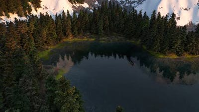 A Small Lake Surrounded By Woods 02