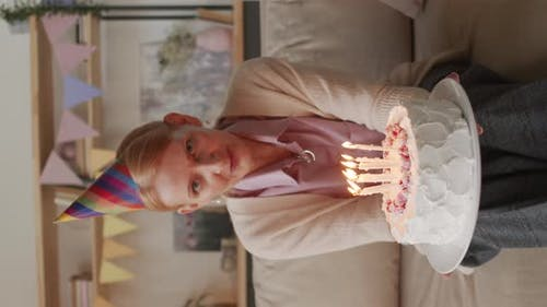 Middle-Aged Lady Blowing Out Candles
