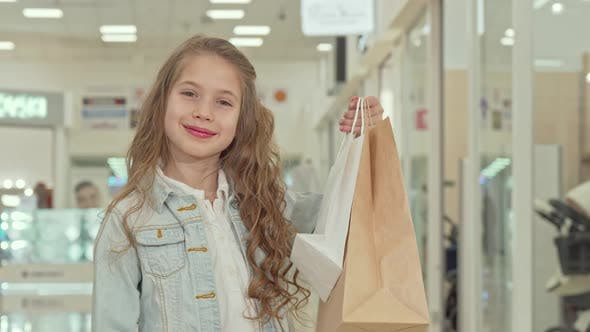 Thumbnail for Happy Cute Little Girl Showing Thumbs Up at the Shopping Mall