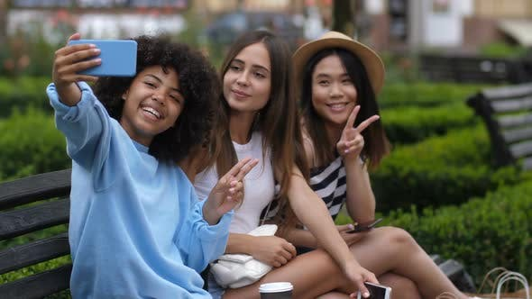Thumbnail for Carefree Relaxed Girls Taking Selfie on Cellphone