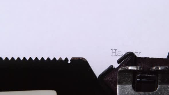 Thumbnail for Man Is Typing a Letter on the Typewriter of a Happy New Year. Close Up