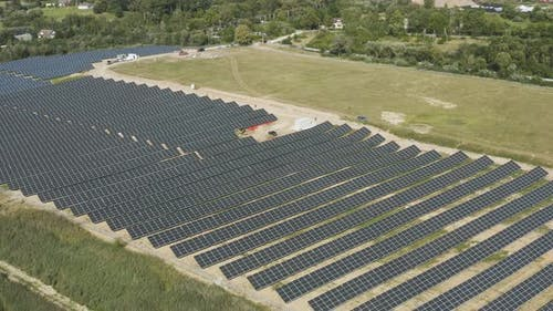 Solar Panels Farm Field Producing Green Renewable Electric Power