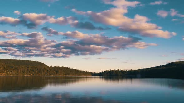 Thumbnail for Dramatic Time Lapse of Clouds Over Empty Lake During Golden Hour