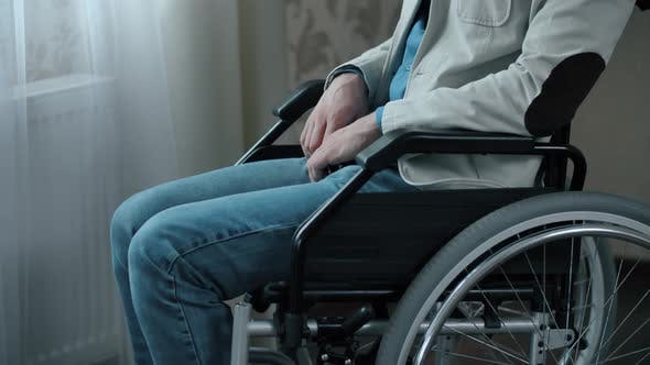 Thumbnail for Man in a Wheelchair at the Room